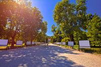 Tivoli park and in Ljubljana walkway in red sun haze view