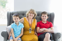 Mid-age woman with two boys indoor