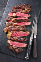 Barbecue Wagyu Tagliata di Manzo Entrecote as close-up on a slate