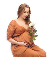 happy pregnant woman with white rose flower