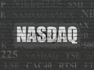 Stock market indexes concept: NASDAQ on wall background