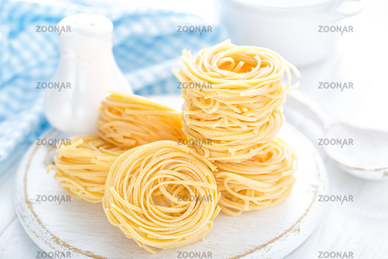 Raw pasta on white background closeup