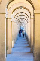 Vasari Corridor with tourists in Florence, Italy