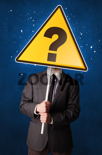 Businessman holding question sign
