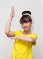 Girl raises his hand up