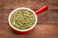pumpkin seeds in a stoneware cup
