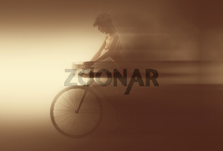 Naked woman with a bicycle. Image with a blurry, moving effect