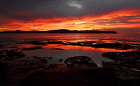 Vivid red dawn scene Pearl Beach Australia