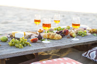 Beach picnic table with rose wine