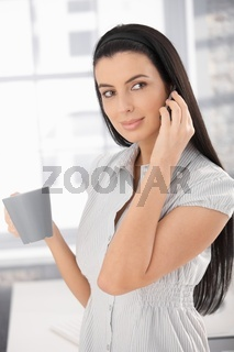 Girl in office with coffee