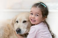 Beautiful kid girl with her dog - Gold retriever