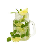 Close up mason jar of mojito isolated on white