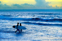 Silhouette of surfers couple