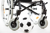 Wheelchair for invalid or disabled person and soccer ball