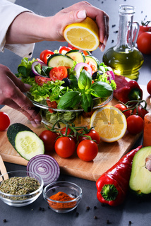 Preparation of a vegetable salad from fresh organic ingredients.