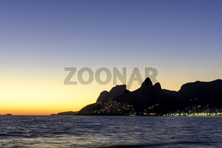 Night arriving at the Arpoador stone, Ipanema beach
