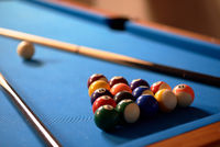 Billiard balls in a blue pool table