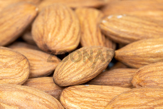 Raw Almond nuts for roasting closeup