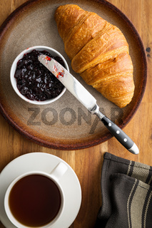 Tasty buttery croissant with jam.