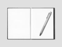 Blank open notebook and pen isolated on grey