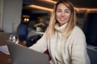 Attractive blond woman working on a laptop