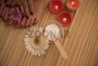 female feet and hands at spa salon