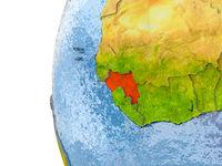 Map of Guinea on model of globe