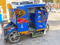 Auto rickshaw parked in the street of Chivay town, Peru
