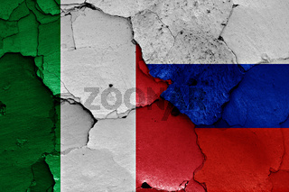 flags of Italy and Russia painted on cracked wall
