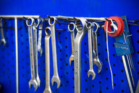Various spanners are hanging on the stand