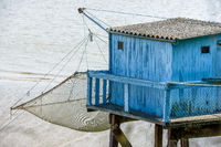 fishing cabin on a sea pier with a net above the water level at Talmon french village
