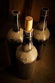 Three old wine bottles