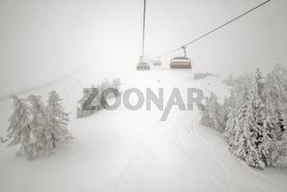 Fog and snowfall on ski resort