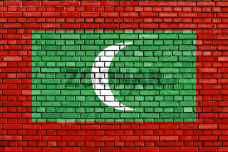 flag of Maldives painted on brick wall