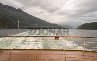 Cruise ship sails under Hardanger bridge in Norway