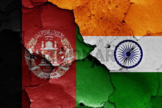 flags of Afghanistan and India painted on cracked wall