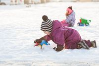 Children play on the snow