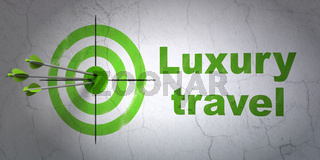 Travel concept: target and Luxury Travel on wall background