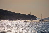 Island of Zlarin sailing bay at sunset view