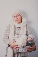 Woman with basket of balls of woolen yarn
