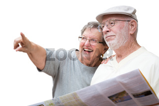 Happy Senior Adult Couple with Brochure Pointing Isolated on a White Background.