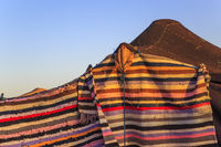 A tent made of camel skin with different colours