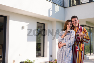 Young beautiful couple in bathrobes