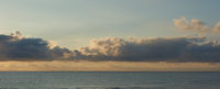 Beautiful sunrise above the Mediterranean Sea. Cloudy sky, tranquil Sea. Spain