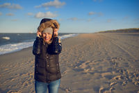 Beautiful woman wearing a waterproof winter coat