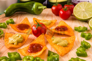 Close up of nachos chips and vegetables