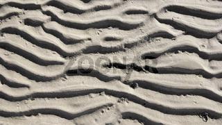 Rippeln im Sand des Wattenmeers bei Ebbe