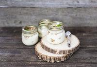 Tiramisu on wooden table with mint