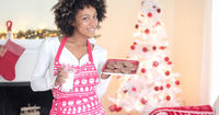Cute young woman holding milk and cookies