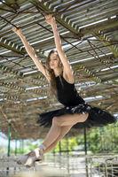 Ballerina posing outdoors
